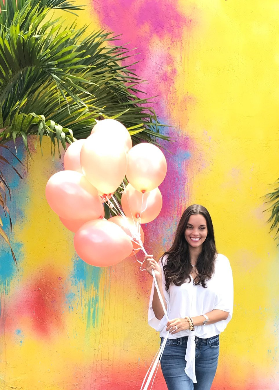 Party Planner in Miami holding rose gold balloons in Little Havana Florida